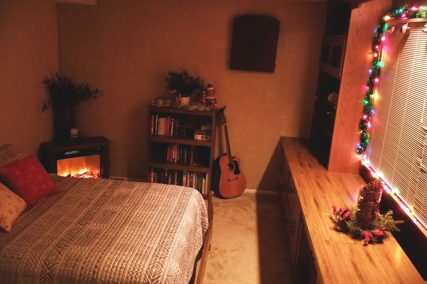 The perfect holiday getaway! Laying in a comfy queen bed next to the fire with a nice book.