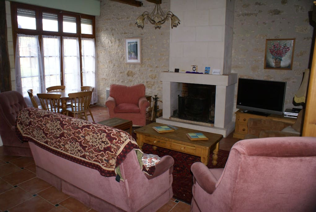 Large living room with log fire, satellite TV, seating for 5
