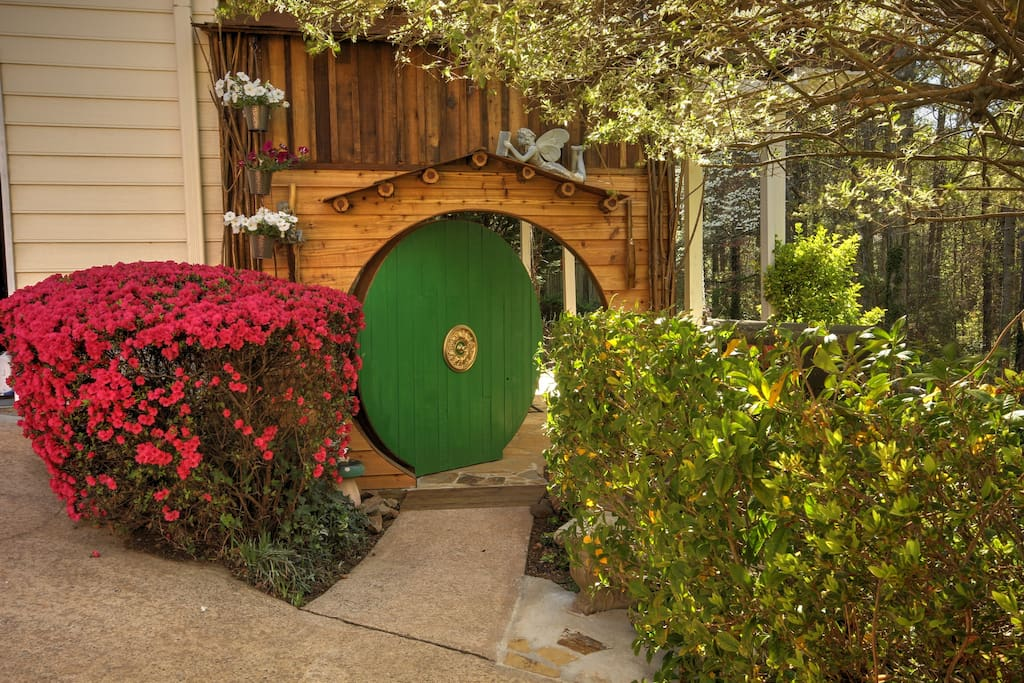 "Hobbit door entrance to private fenced garden and Guest House ""Medwood"""