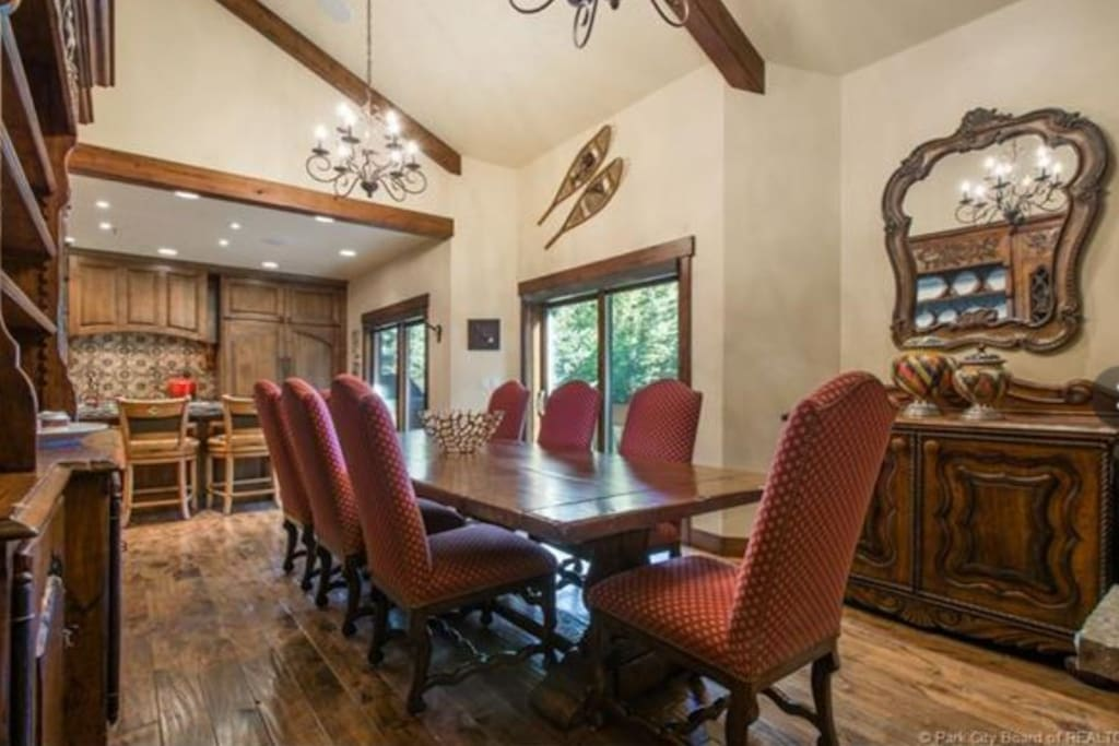 Dining Table has Additional Capacity For Up to 14 in Elegant Dining Room