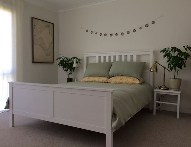 Pure linen bedding in the tranquil and bright bedroom (there are blackout blinds too!).