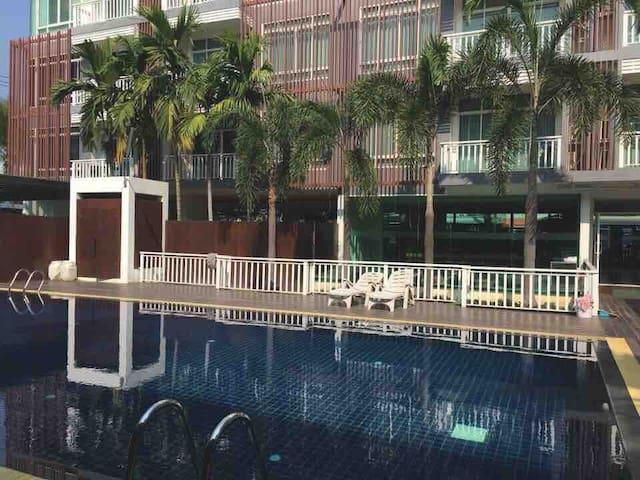 Pool view condo. Nice location