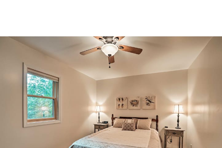 The master bedroom has a queen bed, ceiling fan and USB charging stations.