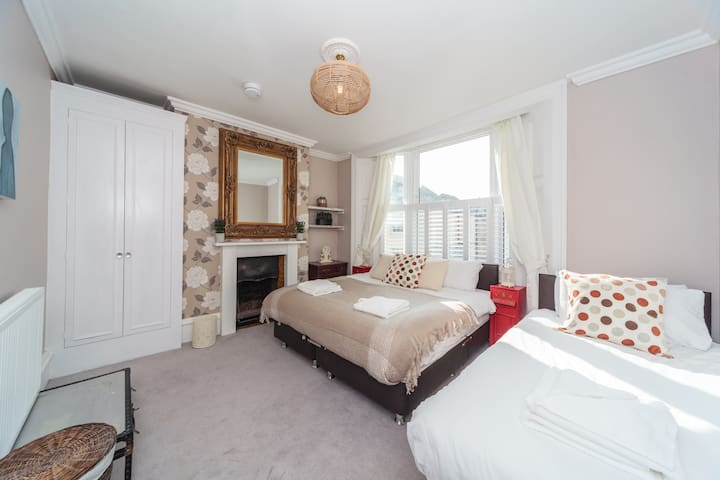 The first floor bedroom with plantation shutters and curtains . It can be three singles or a double and a single.