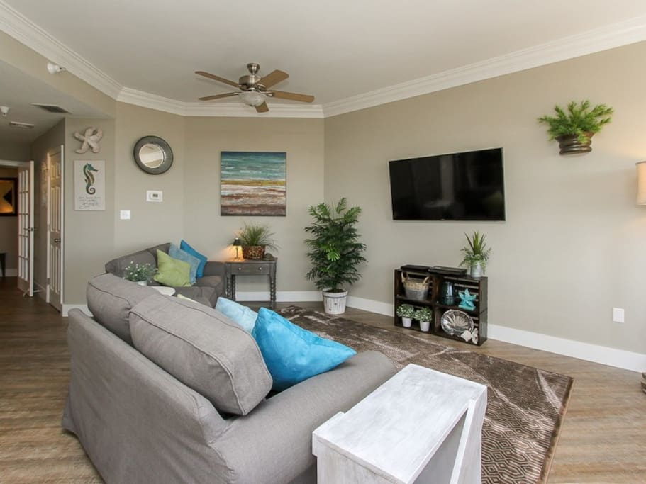 Living Room with New Furniture and Large Flat Screen TV at 1406 Sea Crest