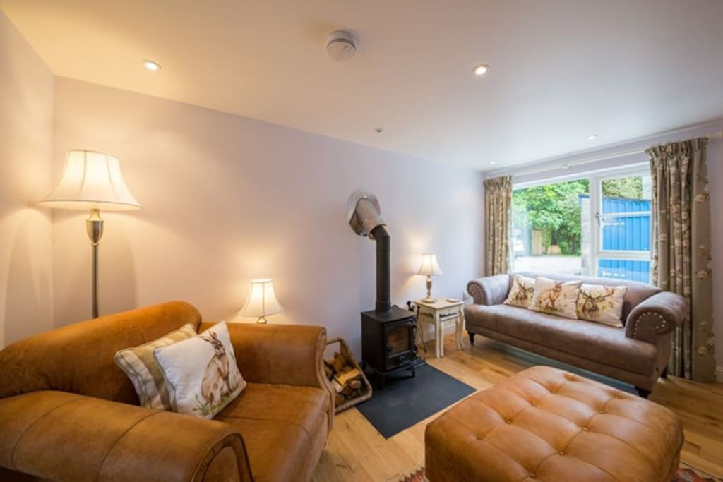 Cosy sitting room area with wood burner