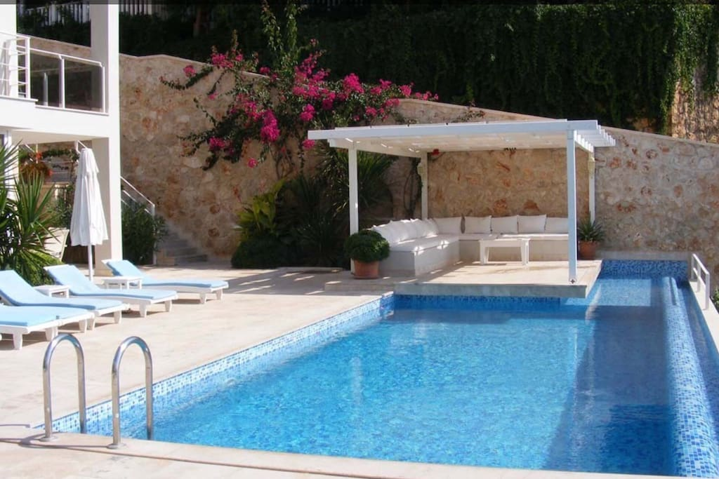 View across pool to pergola and otaman seating