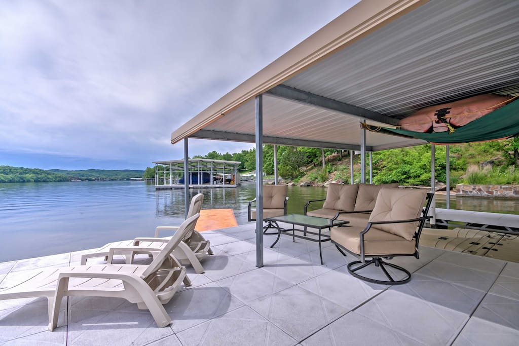 The house has a private dock with slips for boats and jet skis.