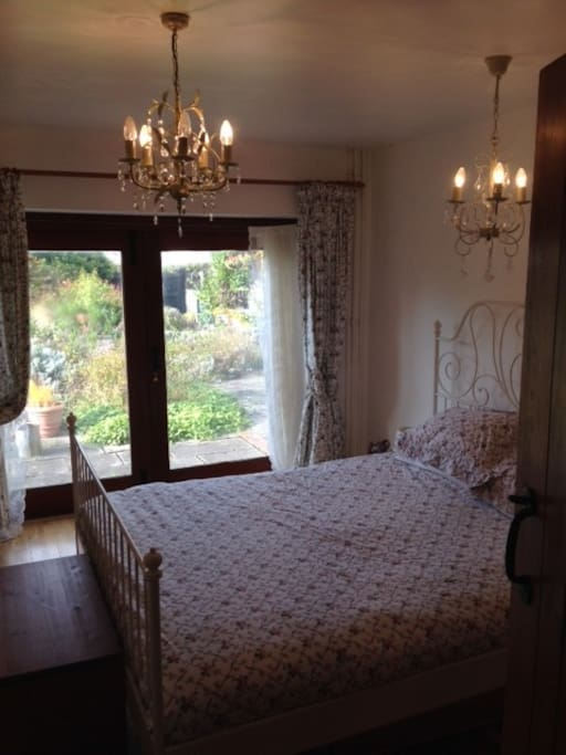 Bedroom with double bed looking out onto the garden