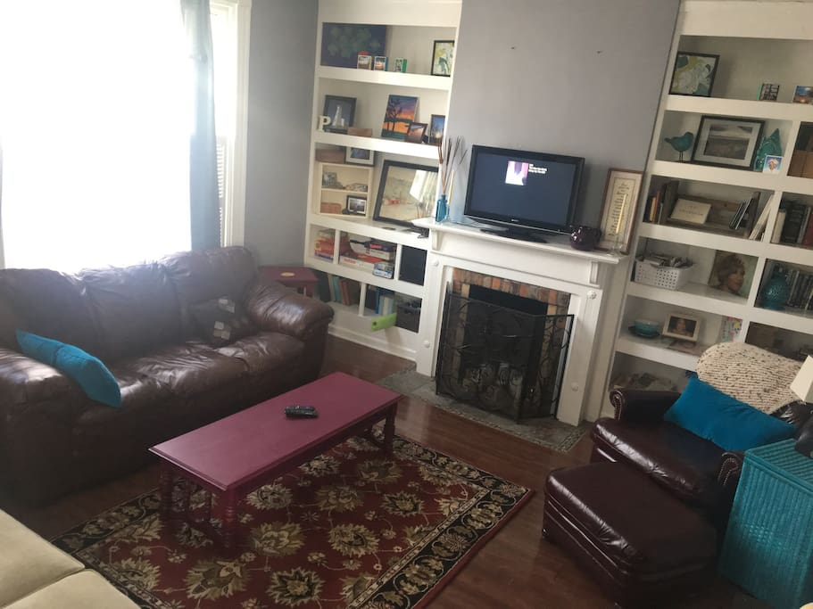 Front room with books, games, and gathering space