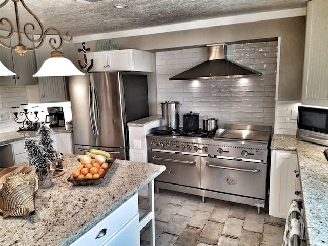 Gourmet chef's kitchen with tons of counter space, giant island and top end appliances!!