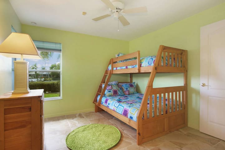 3rd bedroom adorable with chunky wood bunk beds. Plenty of space for 3 children/teens