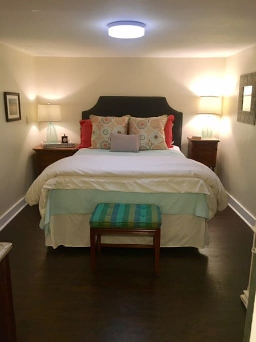 New queen bed with comfortable bedding and outlets on each side for phone chargers!