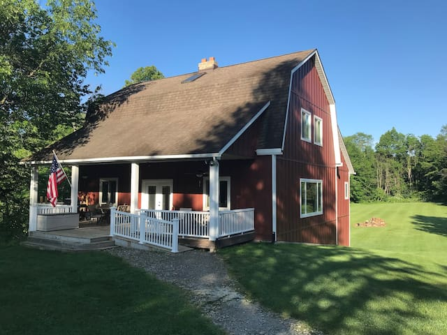 """A Rustic Oasis.  Our guest house, """"The Barn,"""" interior finished using materials from the original 1840's barn wood.  Perfect place for a quiet getaway or a large gathering.  Handicap accessible."""