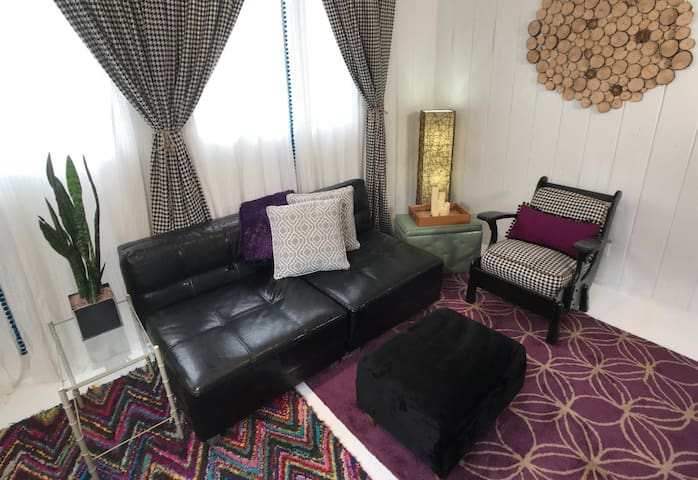 Leather chairs make two singles or one queen fold out bed in the livingroom.