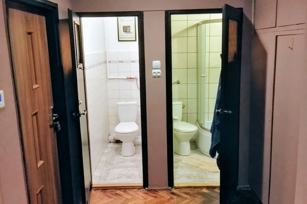 Bathroom with toilet, and separated toilet in common area.