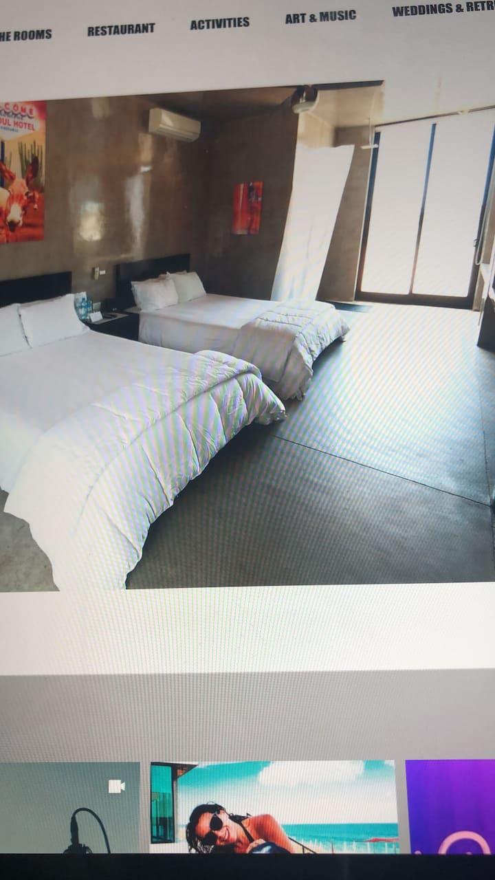Double Queen Bedroom at VidaSoul Hotel