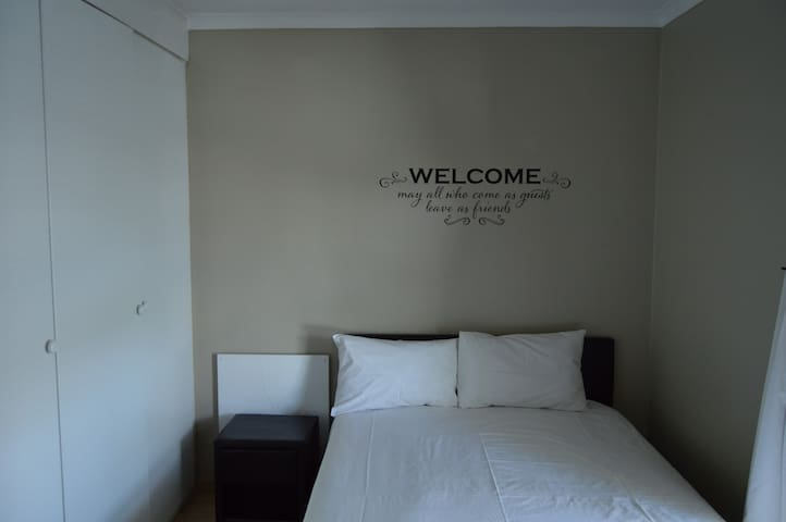 1st Guest bedroom with Queen size bed & study desk with chair & Air Conditioning