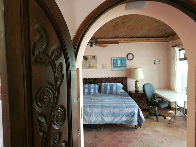 Jacaranda Balcony Room on Chorro