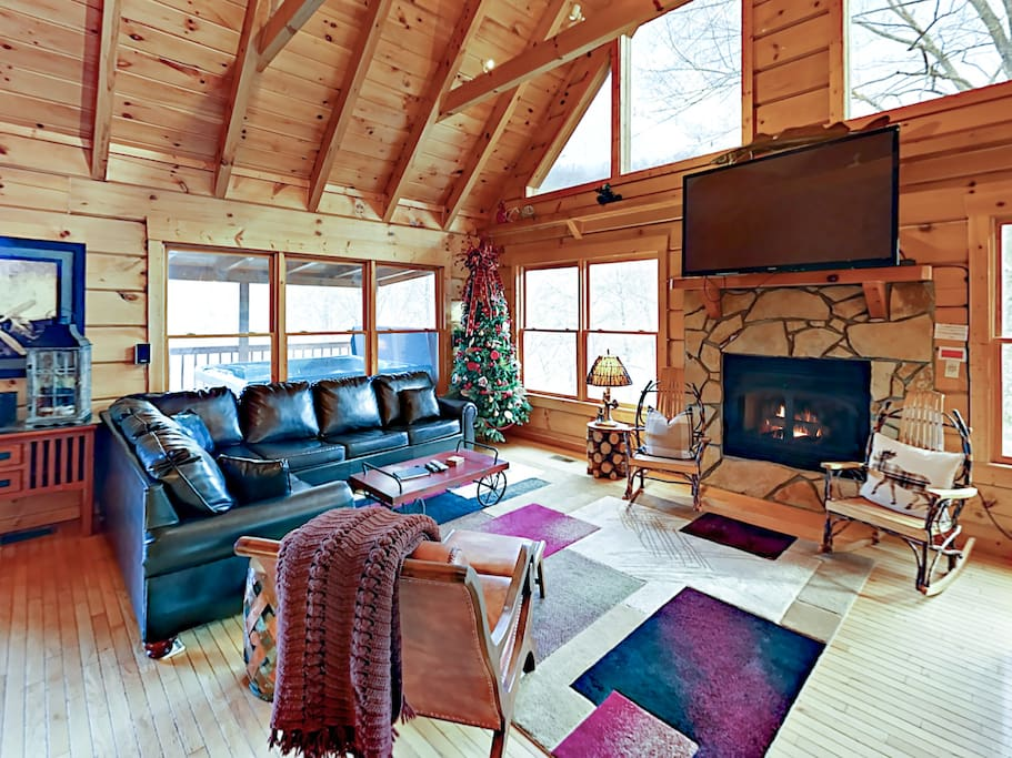 Seating for 7 in the bright and open living area with a sleeper sofa, gas fireplace, flat screen TV, and complimentary Wi-Fi.
