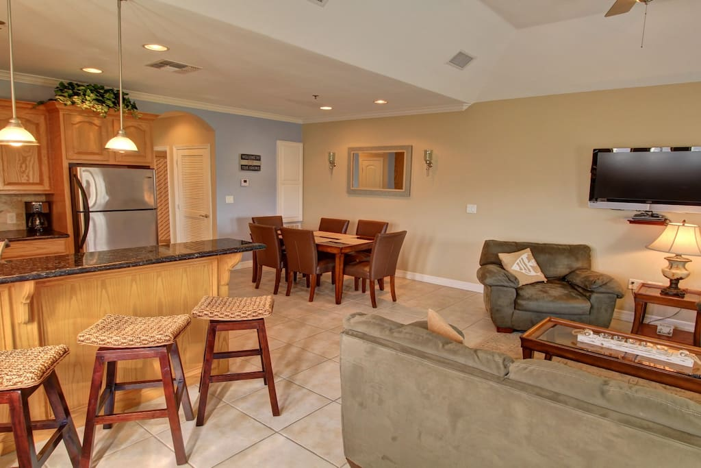Tile floors line the open-concept living and dining areas.