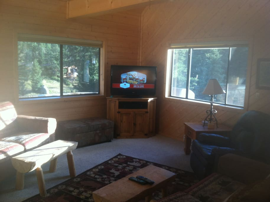 Cabin has large windows with 360 degree mountain views