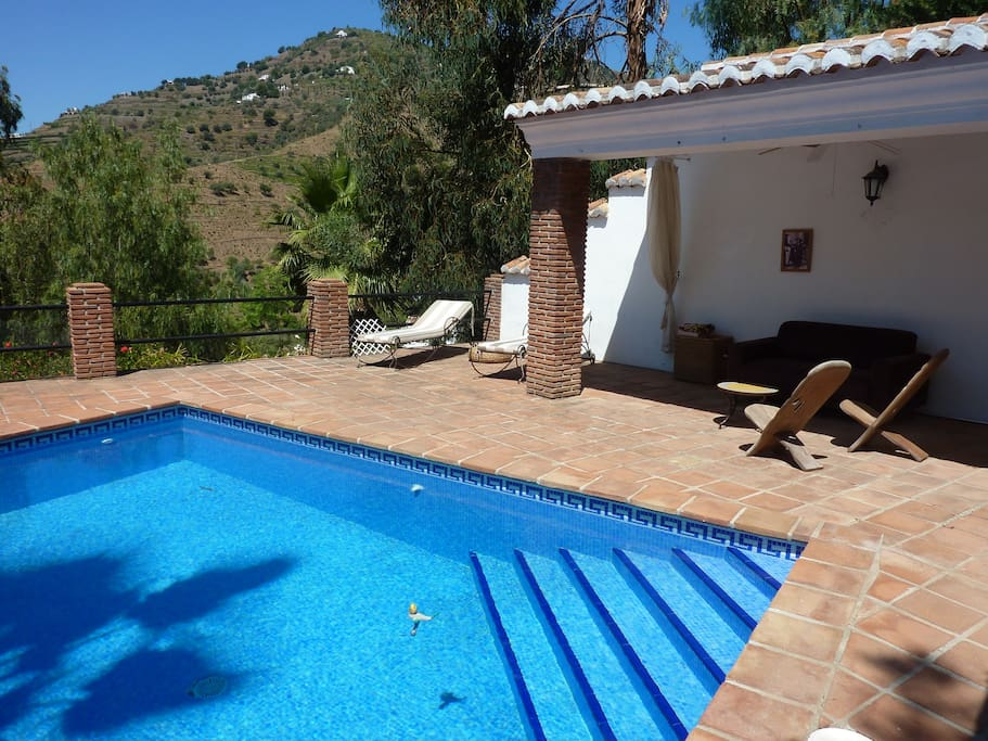 Private pool with a relaxation area with benches, coffee table and sun decks welcomes guests.