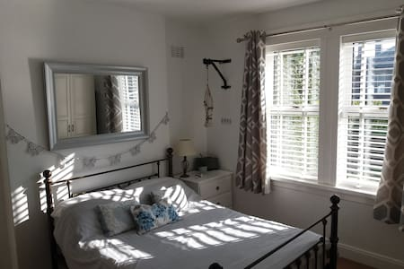 Beautiful private bedroom + bathroom + TV lounge