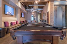 Club room w/ pool table and flat screen TV
