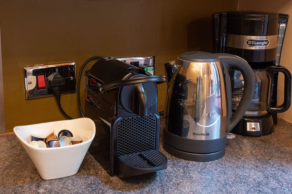 The Nespresso coffee machine with nespresso milk frother and pods