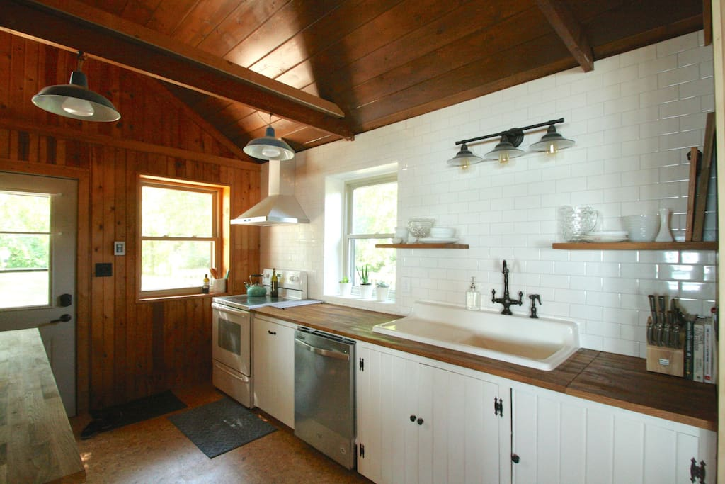 View of the fully equipped kitchen. This 1948 cottage has a lovely mix of vintage and modern features throughout.
