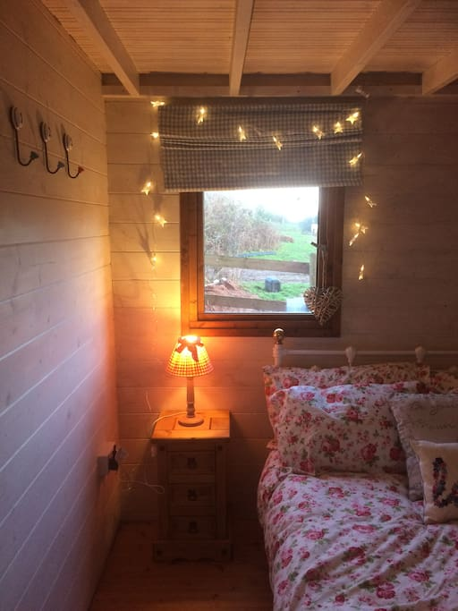 Pretty cosy bedroom with electric heater and electric blanket.