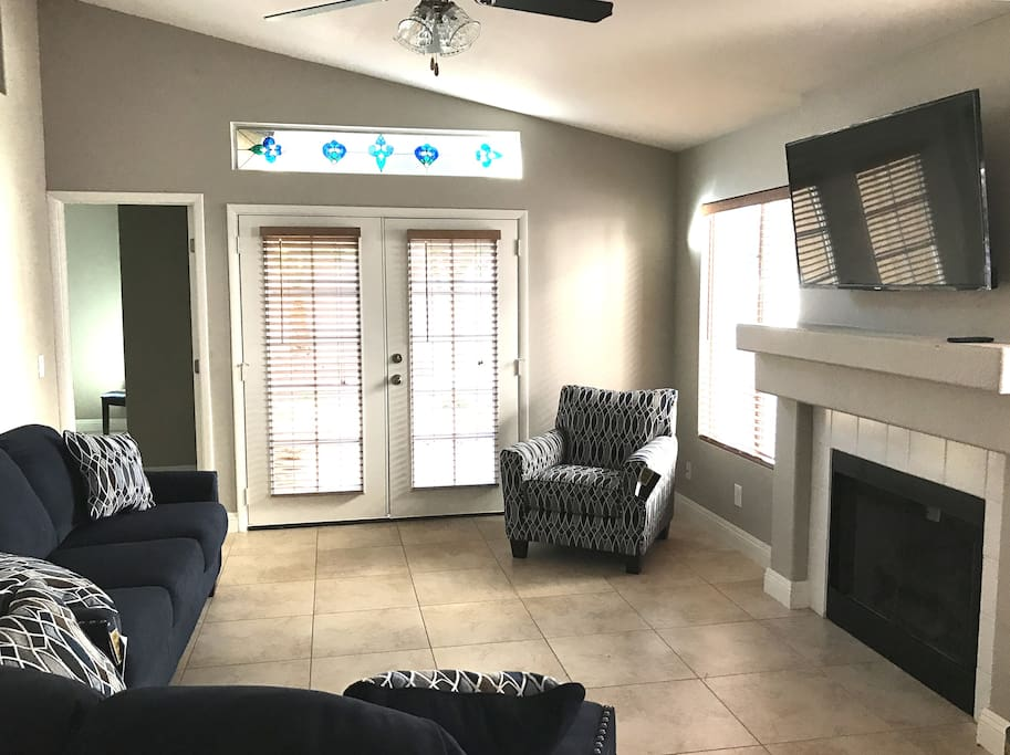 Main living area with 50 in. TV