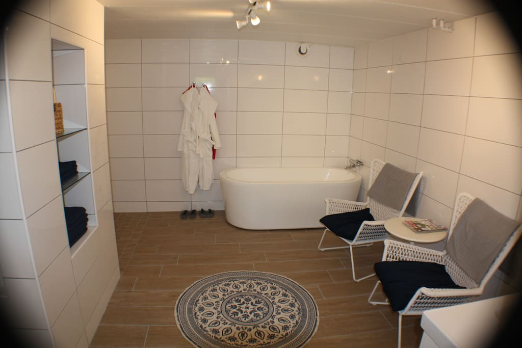 Large bathroom with bath, shower and toilet