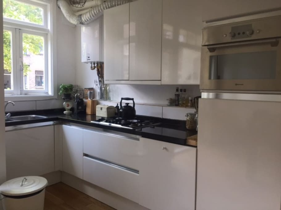 Kitchen with dishwasher, oven (microwave), washing machine and dryer