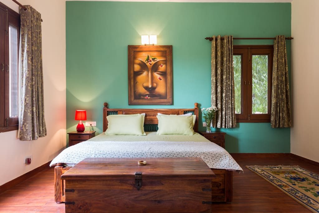 Aesthetically decorated King's bed in First Floor Suite