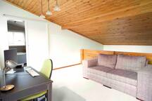 Upstairs loft with couch and office