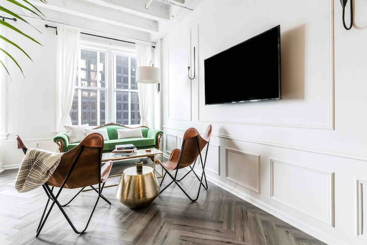 Seating area with natural light and a 360 degree TV mount for viewing at any location.