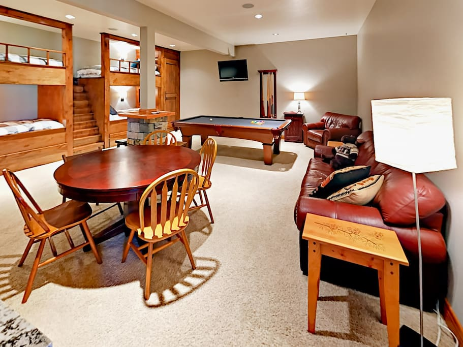 Spacious game room on the lower floor with 2 sets of twin-over-twin bunk beds - with trundle beds for each bunk bed. Enjoy board games, a full-size pool table, dart boards, wet bar, and mini fridge.