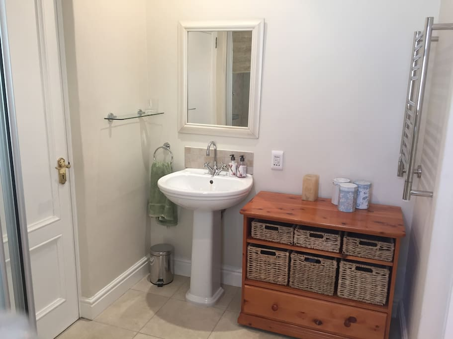 Ensuite bathroom with shower, basin and toilet