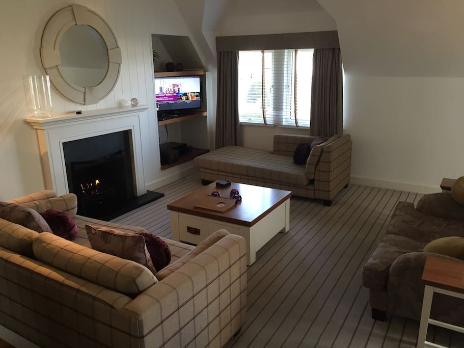 Spacious living area - real flame gas fire, TV integrated sound system.