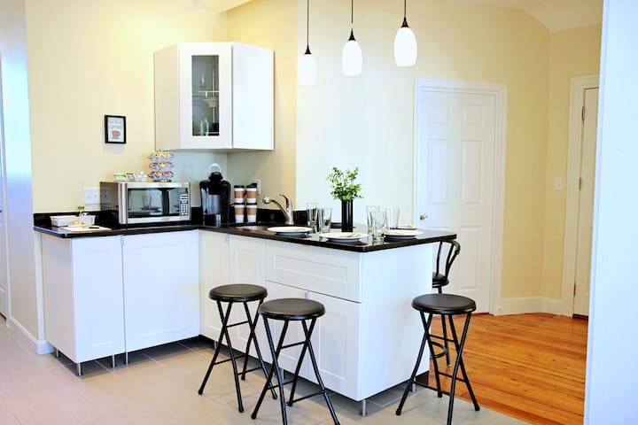 Our apartment offers a beautiful eat-in kitchen complete with plates, silverware, glasses, mugs and all your essentials for an intimate dinner, lunch or breakfast!