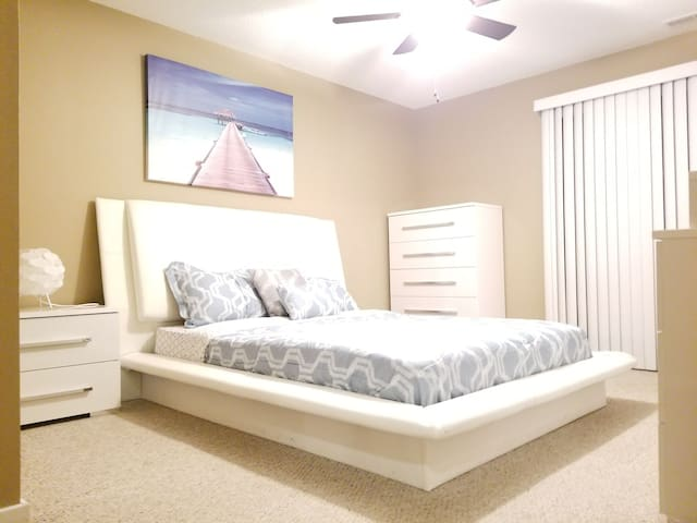 Master bed room with patio, private bath and private walk in closet