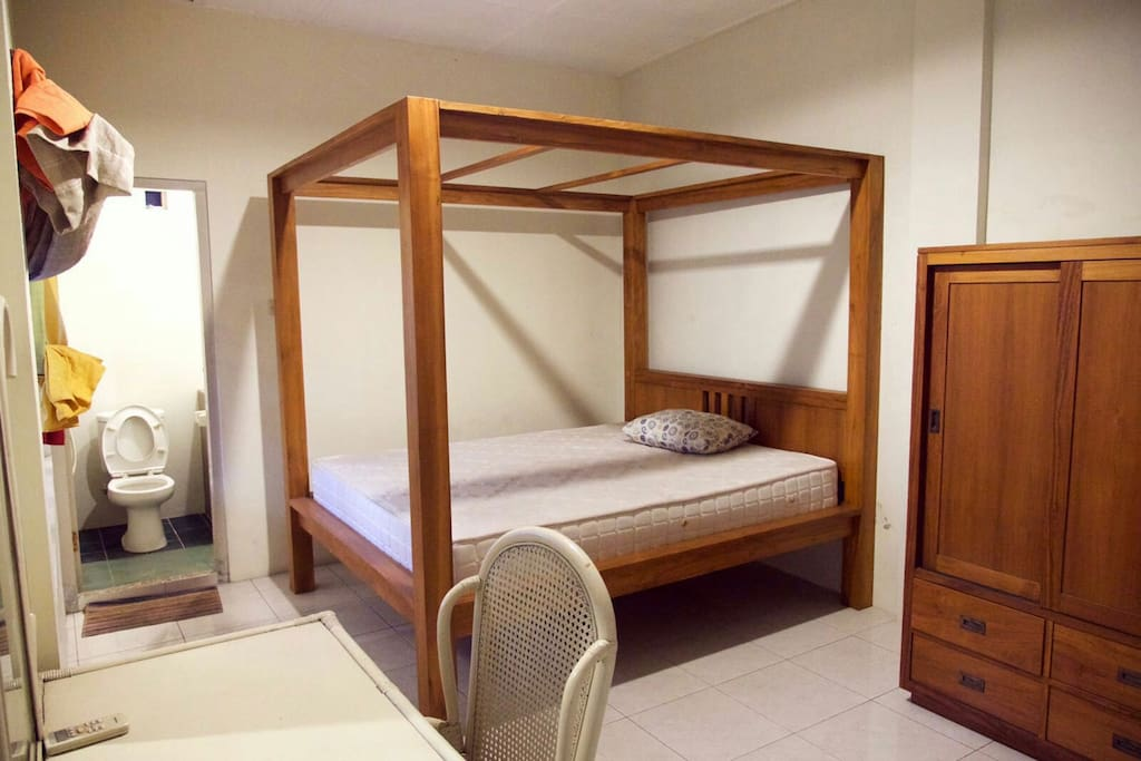 Beautiful master bed room with bathroom inside equipped with shower with hot and cold water
