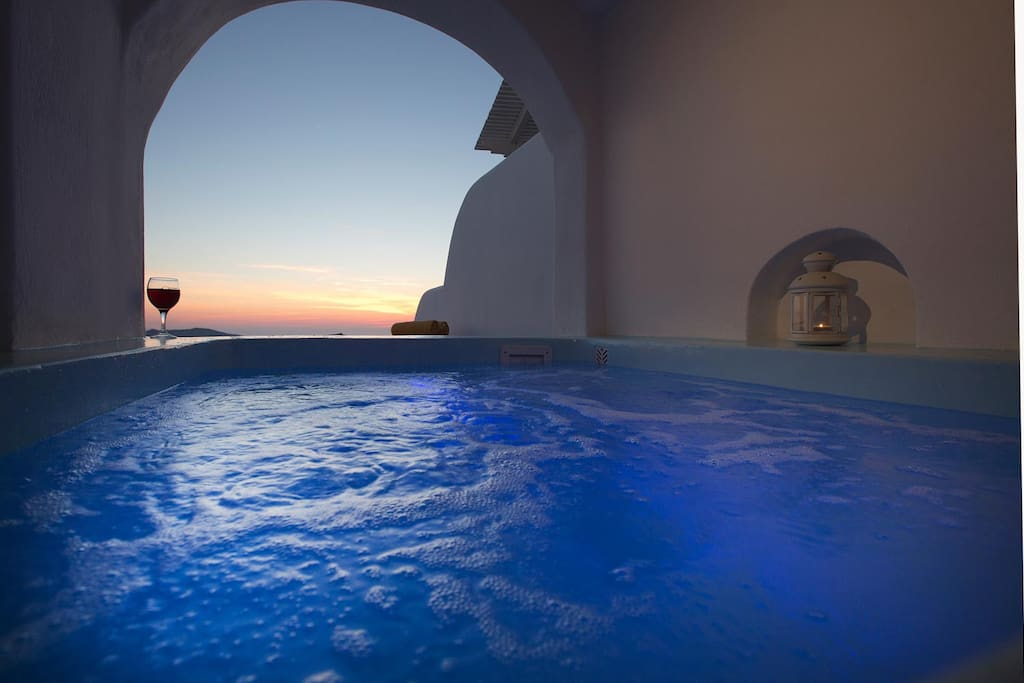 Balcony with view at the sea, sunset, caldera and private  big Jacuzzi Hot-tub