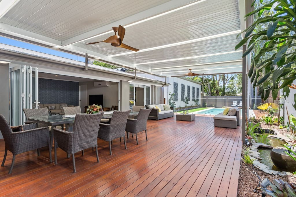 Huge all weather deck leading onto the pool area