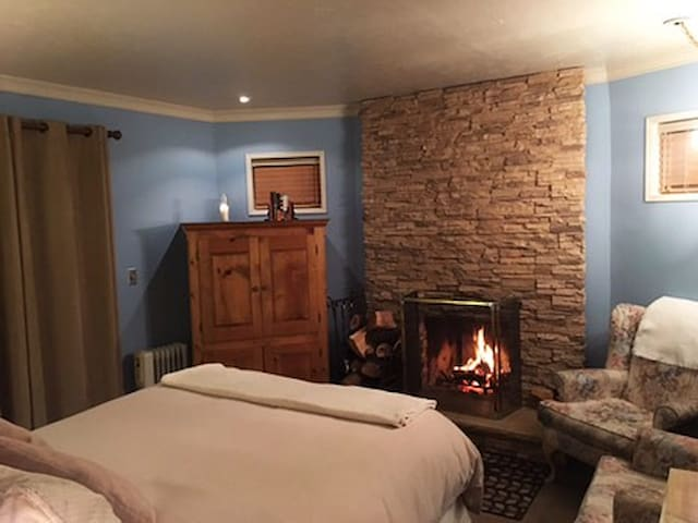 Fireplace at the foot of the bed