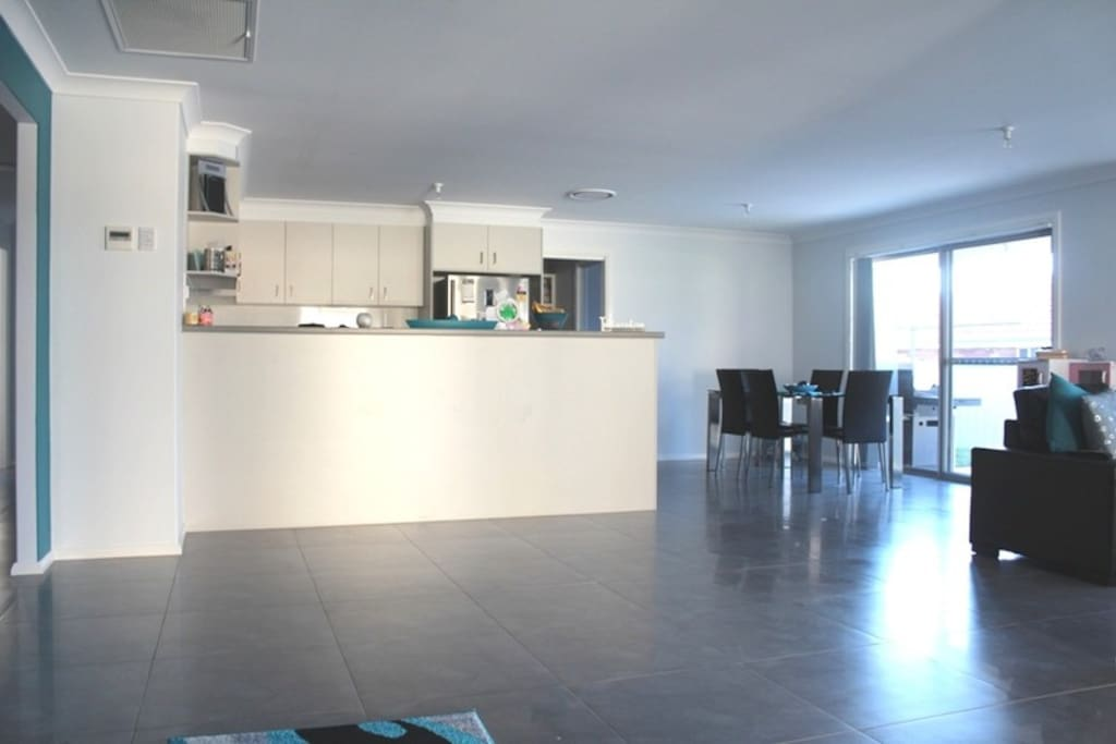 Open plan living/dining/kitchen area, with access to the outdoor dining space