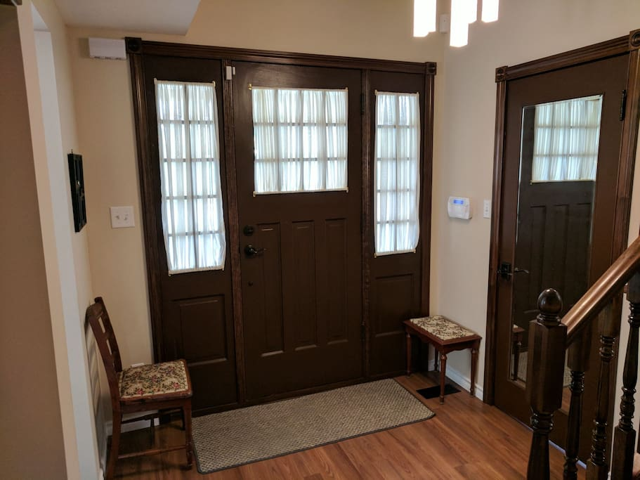 Front entrance with powder room to your left