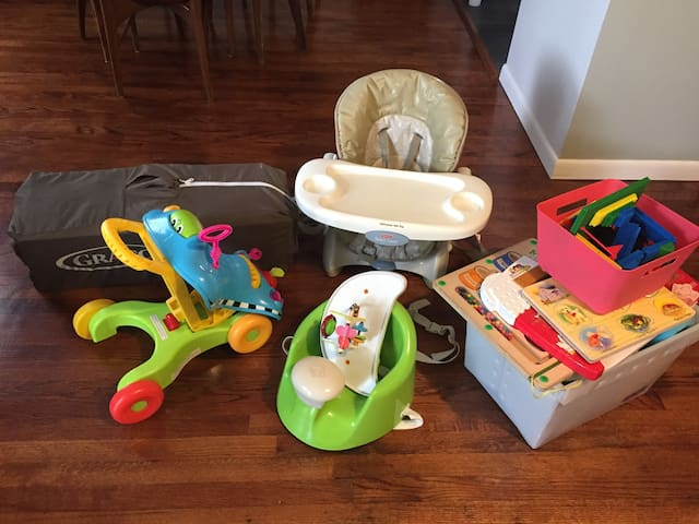 Baby items and toys available for visiting little ones.